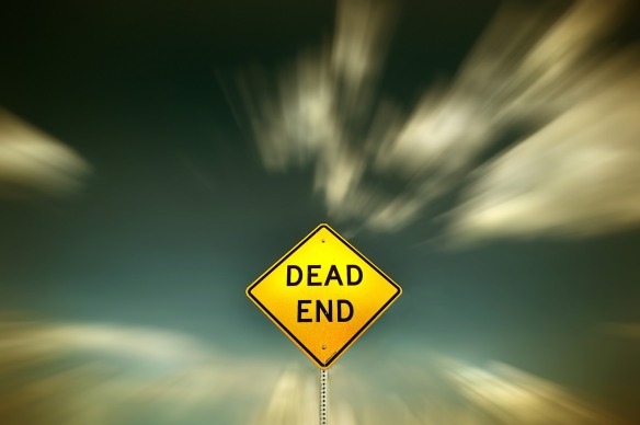 "Road sign reads ""Dead End"""